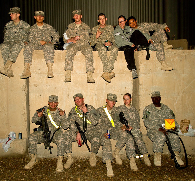 "November 28, 2010. Camp Victory, Baghdad, Iraq. Hundreds of U. S. Military personnel showed up for the show. Troops sitting on a ""T-Wall"" watching the show."