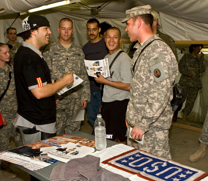 """Hip-Hop artist Ron """"Baby Bash"""" Bryant signs autographs at Camp Victory in Baghdad, Iraq Sept. 7, 2008."""
