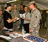 "Hip-Hop artist Ron ""Baby Bash"" Bryant signs autographs at Camp Victory in Baghdad, Iraq Sept. 7, 2008."