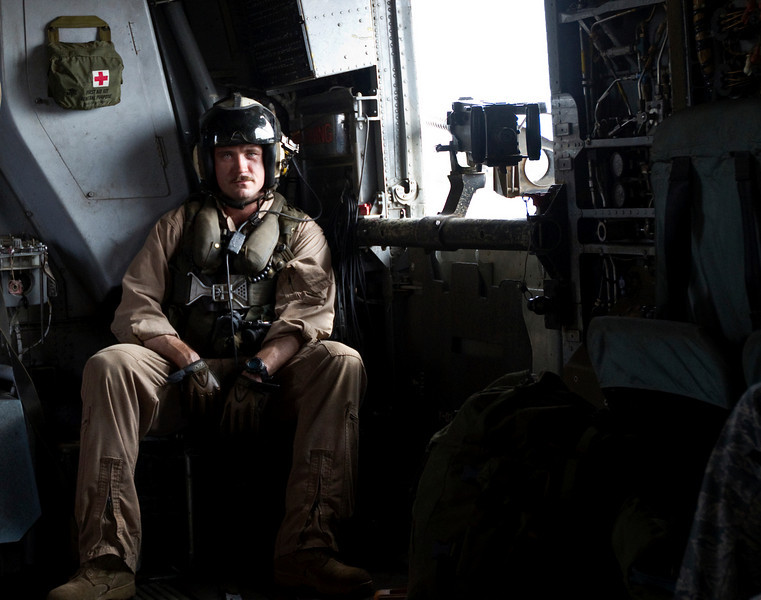 NFL Tour with Drew Brees, Billy Miller and Donnie Edwards. Aircrew member onboard a U. S. Marine Corps CH-53 helicopter over Djibouti.