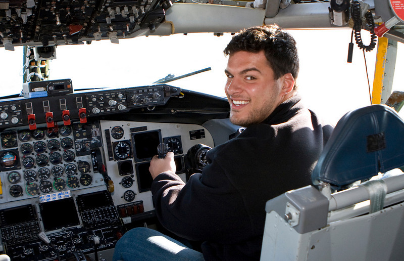 Luis Castillo, San Diego Chargers sits in the cockpit of a U. S. Air Froce KC-135 refueling tanker.