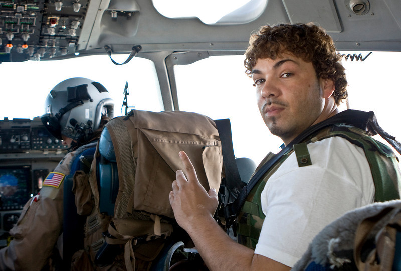 "Hip-Hop artist Ron ""Baby Bash"" Bryant on board a U. S. Air Force C-17 aircraft on his way to Baghdad, Iraq, Sept. 7, 2008."