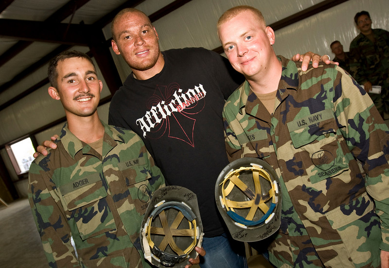 USO NFL Tour To Guantanamo Bay, Cuba June 26-29, 2009. Billy Miller poses with SWCN Lane Adger (L) and EOCN Brian Betts as they show off their autographed helmets. Adger and Betts belong to Amphibious Construction Battalion 2, Guantanamo Bay, Cuba.