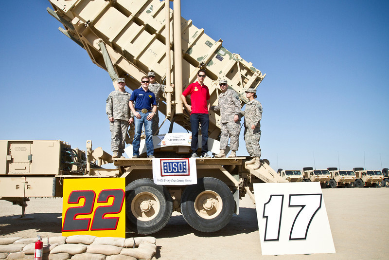December 7, 2012-NASCAR drivers Joey Logano and Ricky Stenhouse, Jr. break away from the raceway to deliver holiday cheer to troops overseas on USO Tour.