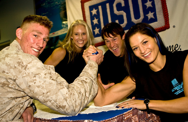American Gladiator, Jet,shares a light hearted game of arm wrestling with a Marine of the 26th Marine Expeditionary Unit aboard NSA Bahrain, Bahrain, November 11, 2008 as part of the USO American Gladiators Tour To Bahrain and Dijbouti.