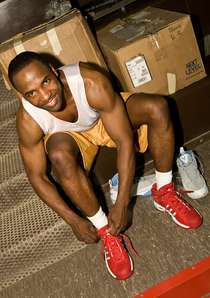 A Soldier tries on the new shoes he received for participating in the USO's Operation Hardwood VI.