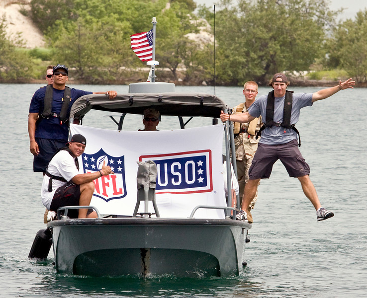 USO NFL Tour To Guantanamo Bay, Cuba June 26-29, 2009. L-R Donnie Edwards, Billy Miller and Drew Brees go on a check ride with members of MSST (Maritime Safety And Security Team) 91101 from Seattle, WA. They are pictured with BM3 James Gillette of Tacoma, WA.