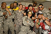"Hip-Hop artist Ron ""Baby Bash"" Bryant, along with Los Angeles morning show hosts Kurt ""Big Boy"" Alexander and Emmanuel ""DJ Eman"" Coquina pose with Soldiers, Sailors, Marines and Airmen at Camp Victory in Baghdad, Iraq Sept. 7, 2008."
