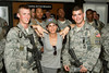 June 10, 2011. At an undisclosed military base in the Middle East. Health and Wellness expert Jillian Michaels and Fitness Guru Marco Borges lead boot camp style work out sessions while actress/media personality Celines Toribio adds excitement. Michaels poses with two members of the U. S. Air Force Security team, Airman First Class Daniel Woods, 22 of Ticonderoga, NY (Left) and Airman First Class Ron Cela, 20, from Bohemia, NY (right).  USO photo by Mike Clifton.