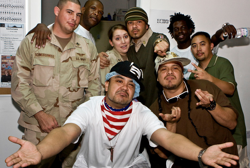 """Hip-Hop artist Ronald """"Baby Bash"""" Bryant, along with Los Angeles morning show hosts Kurt """"Big Boy"""" Alexander and Emmanuel """"DJ Eman"""" Coquina meet with members of the """"Wounded Warrior Battallion"""" of the Expeditionary Medical Facility Kuwait, Kuwait on Sept. 05, 2008."""