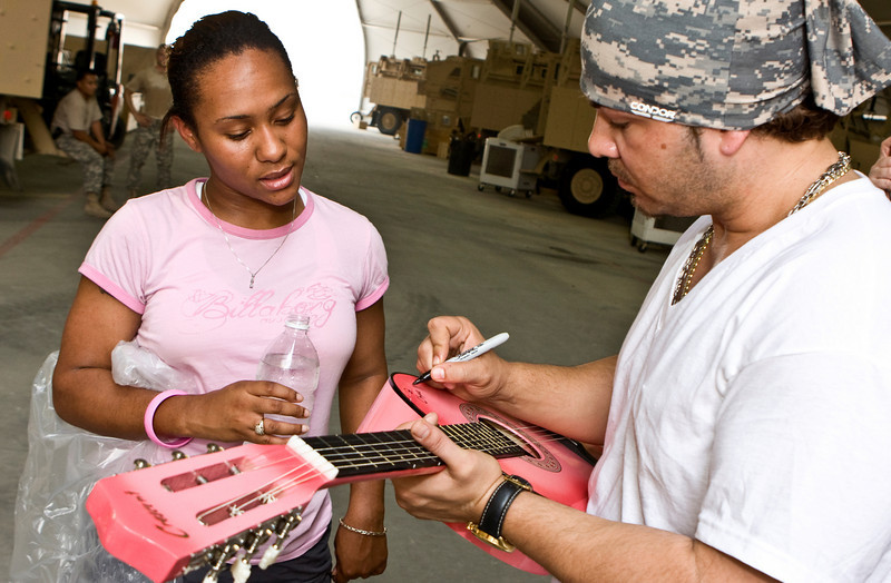 "Hip-Hop artist Ron ""Baby Bash"" Bryant signs autographs at Tallil Air Base, Iraq, Sept. 8, 2008."