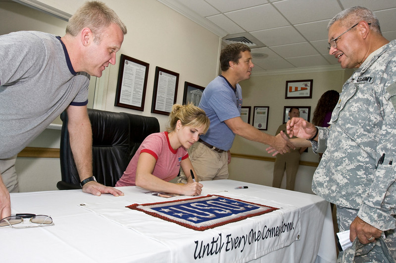 """Fans line up to see actors Terry Serpico, Sally Pressman and Brian McNamara of Lifetime's top-rated drama """"Army Wives"""" at the U. S. Naval Hospital in Guantanamo Bay, Cuba as part of USO/Armed Forces Entertainment tour December 12-16."""