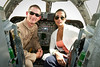 June 9, 2011. At an undisclosed military base in the Middle East. Health and Wellness expert Jillian Michaels and Fitness Guru Marco Borges lead boot camp style work out sessions while actress/media personality Celines Toribio adds excitement. Celines Toribio poses in the cockpit of a U. S. Air Force B-1 bomber with U. S. Air Force Captain Rob Jackson of Ellsworth, SD. USO photo by Mike Clifton.