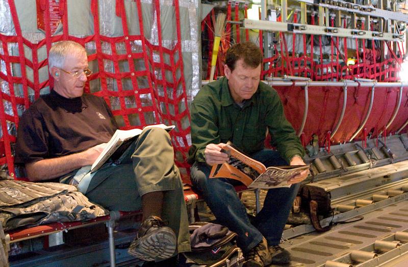 Joe Inman (l) and Tom Watson onboard a U. S. Marine Corps C-130 aircraft flying over Iraq.