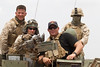 NFL Tour with Drew Brees, Billy Miller and Donnie Edwards. New Orleans Saints tight end, Billy Miller onboard a U. S. Marine LAV )Light Armored Vehicle) in the Djibouti desert as out helo lifts off after dropping us off. I am in the lead LAV with Drew Brees.