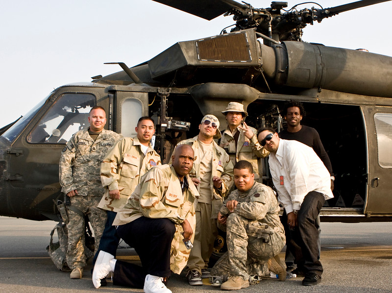 """Hip-Hop artist Ronald """"Baby Bash"""" Bryant, along with Los Angeles morning show hosts Kurt """"Big Boy"""" Alexander and Emmanuel """"DJ Eman"""" Coquina prepare to fly out of Camp Arijan, Kuwait on a U. S. Army UH-60 Blackhawk helicopter on Sept. 05, 2008."""