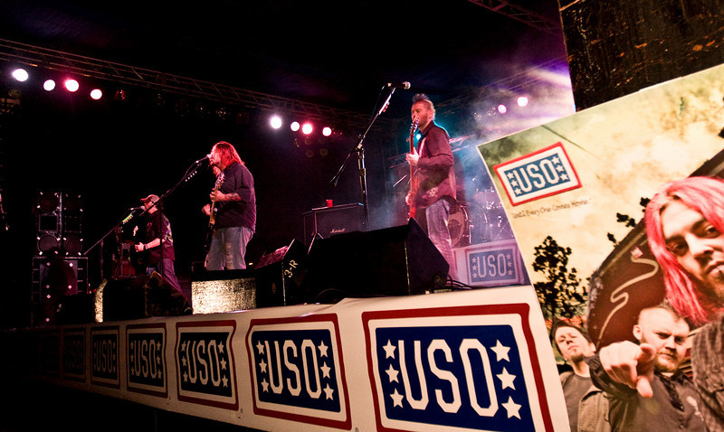 """Members of the South African rock band, """"Seether"""" performed for hundreds of military members and their families at Marine Corps Air Station Iwakuni, Japan as part of the USO/Armed Forces Entertainment May 2009 Japan Tour. While there they posed for photos and signed autographs on CDs, posters, guitars and more."""