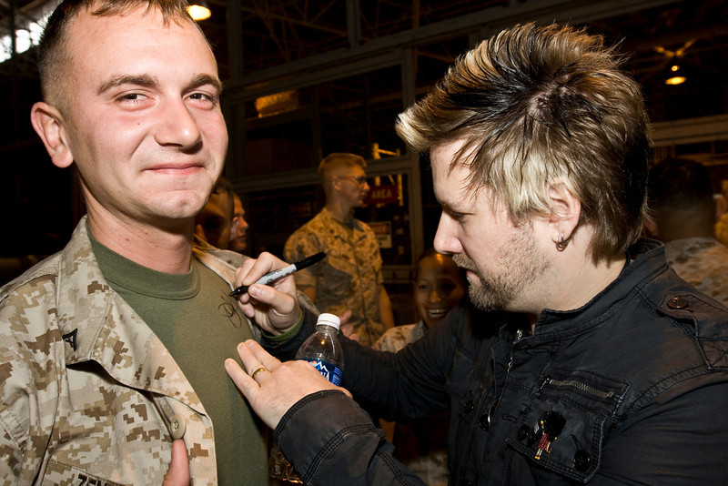 "Members of the South African rock band, ""Seether"" met with military members and their families at Marine Corps Air Station, Iwakuni Japan as part of the USO/Armed Forces Entertainment May 2009 Japan Tour. While there they visited various units, posed for photos and signed autographs on CDs, posters, guitars and more. Shown here is John Humphrey autographing the t-shirt of Marine Lance Corporal Lee Zentmie of CLC (Combat Logistics Company)-36. Zentmie is from Portland, OR."