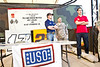 December 7, 2012-NASCAR drivers Joey Logano and Ricky Stenhouse, Jr. break away from the raceway to deliver holiday cheer to troops overseas on USO Tour. Stenhouse (L) and Lagano (R) with U. S. Army Chief Warrant Officer Chris Elliot, 40, from Melbourne, FL.