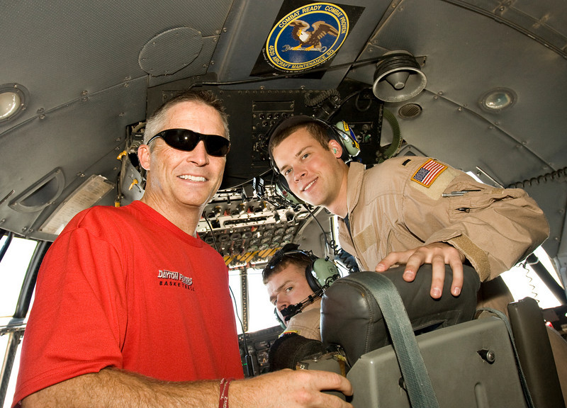 University of Dayton Head Coach, Brian Gregory. In the cockpit of a U. S. Air Force C-130 flying over Iraq.