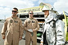 "May 7, 2012. Marine Corps Air Station Futenma, Okinawa, Japan. ""The Big Bang Theory's"" Steven Molaro and Johnny Galecki join Michael Cudlitz, Regina King and Ben McKenzie of ""Southland"" on a seven-day, spirit lifting USO Tour to Japan. Ben McKenzie tries on a fire suit."