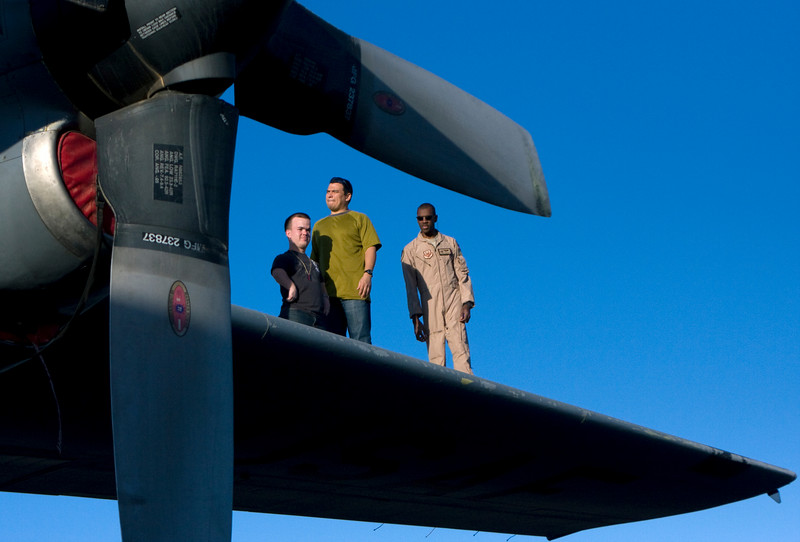 Carlos Mencia and Brad Williams on top of the wing of a U. S. Air Force C-130 aircraft in Kuwait. 11/28/07.
