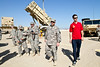 December 7, 2012-NASCAR drivers Joey Logano and Ricky Stenhouse, Jr. break away from the raceway to deliver holiday cheer to troops overseas on USO Tour. Joey Logano walks with U. S. Army Chief Warrant Officer Chris Elliot, 40, from Melbourne, FL.