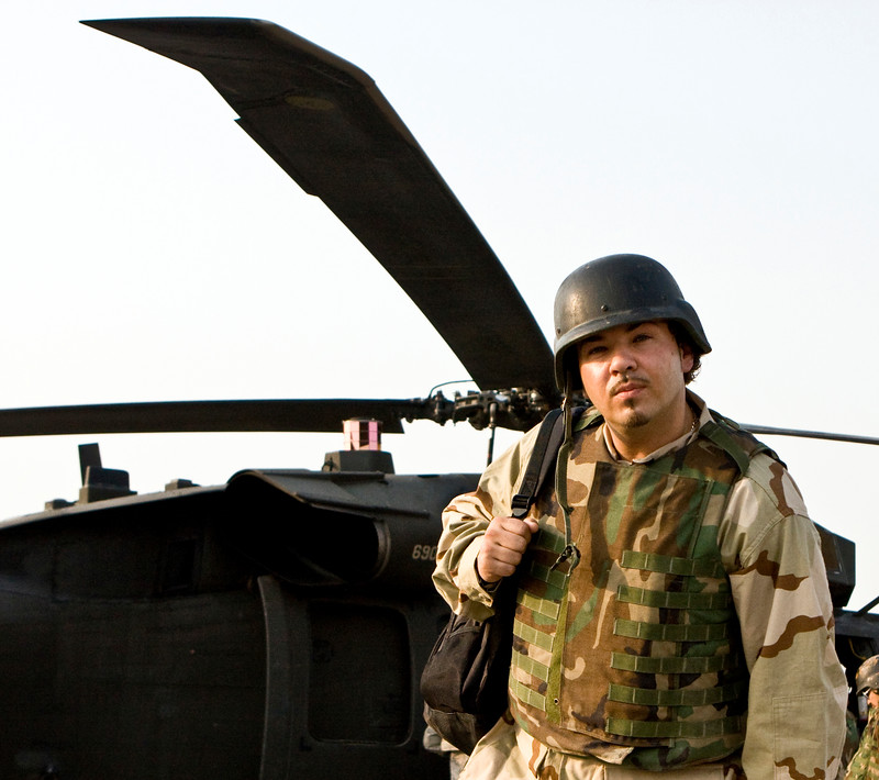 """Hip-Hop artist Ronald """"Baby Bash"""" Bryant prepares to leave Camp Arifjan, Kuwait aboard a U. S. Army UH-60 Blackhawk helicopter, Sept. 5, 2008."""