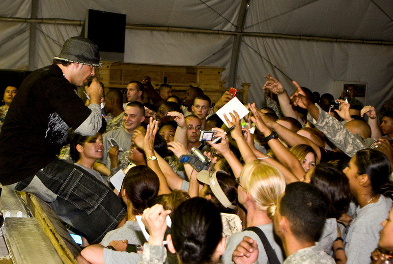 """Hip-Hop artist Ron """"Baby Bash"""" Bryant entertains hundreds of Soldiers, Sailors, Marines and Airmen at Tallil Air Base, Iraq Sept. 8, 2008"""