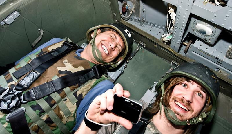 Helicopter ride to Camp Taji, Iraq, January 22, 2009. The crew did an inflight stall practice. The nose of the aircraft is pointing nearly straight up. These guys were loving it. Arturo Cisneros (L) and Kyle Peek.