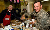 USO Volunteer, Chuck Chambers, left, serves hot chili to U. S. Army Sergeant Michael Blumer, from Blaine, MN, in the USO center at Atlanta's Hartsfield-Jackson International Airport on Feb. 25, 2009.