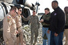 L-R Sportswriter Peter King and National Football League player Mike Rucker of the Carolina Panthers prepare for transportation in a U. S. Army Blackhawk helicopter in Jalalabad; Afghanistan on Friday; March 7; 2008.