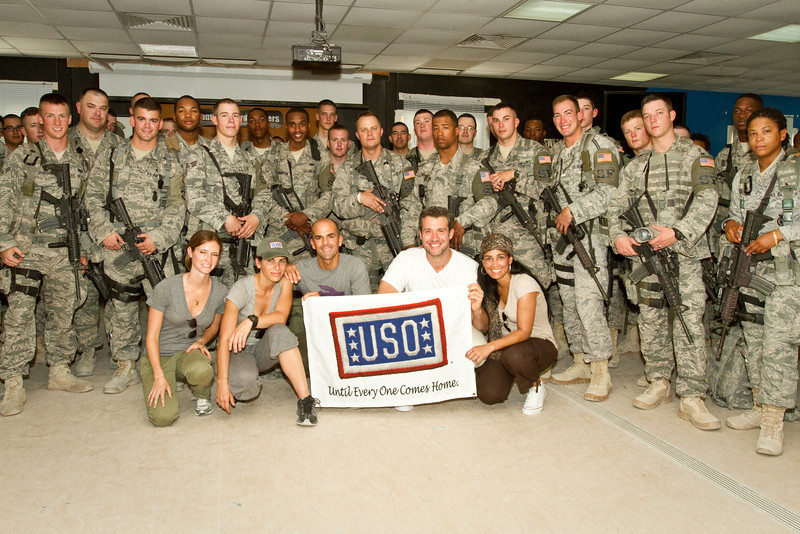 June 10, 2011. At an undisclosed military base in the Middle East. Health and Wellness expert Jillian Michaels and Fitness Guru Marco Borges lead boot camp style work out sessions while actress/media personality Celines Toribio adds excitement. A U. S. Airman enjoys the early morning workout. USO photo by Mike Clifton.