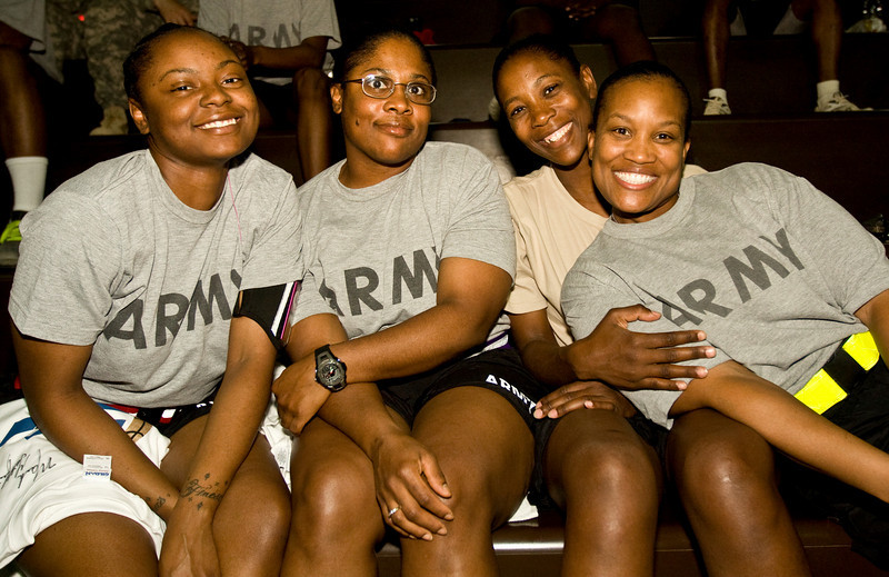 Four Soldiers watch the game at Camp Speicher, Iraq . USO Operation Hardwood VI Tour to Iraq August, 2009.