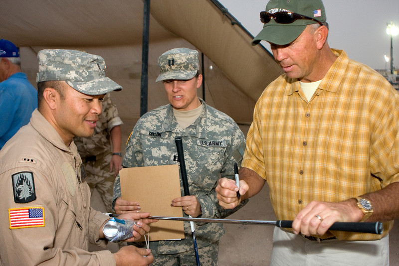 Tom Lehman autographs a golf club for a Soldier at Camp Buering, Kuwait.