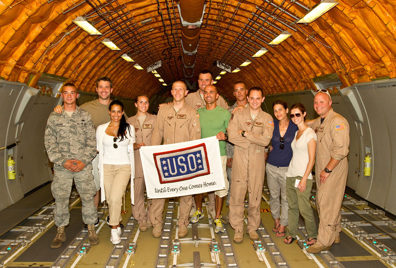 June 7, 2011. At an undisclosed military base in the Middle East. Health and Wellness expert Jillian Michaels and Fitness Guru Marco Borges lead boot camp style work out sessions while actress/media personality Celines Toribio adds excitement. Posing with the crew on board visit to a KC-130 refueling aircraft.