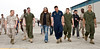 "Members of the South African rock band, ""Seether"" met with military members and their families at Marine Corps Air Station, Iwakuni Japan as part of the USO/Armed Forces Entertainment May 2009 Japan Tour. While there they visited various units, posed for photos and signed autographs on CDs, posters, guitars and more. They are shown walking accross the Marine Corps Air Station Iwakuni flightline with the Marines of VMFA (AW) (Marine Fighter Attack All Weather) Squadron 242 and their families. Back in the day, I spent MANY a miserable day (and night) on this very same flight line. It is great to see that such a dedicated group of young men and women have stepped up and taken our places. Semper Fi Marines!!"