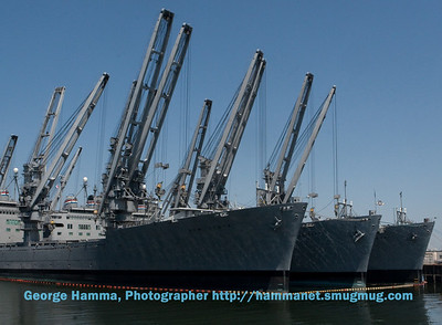 The Hornet is docked next to several other ships in Alameda.