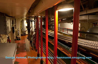 This is a view along the catapult hydraulic shaft with pulleys and cables.