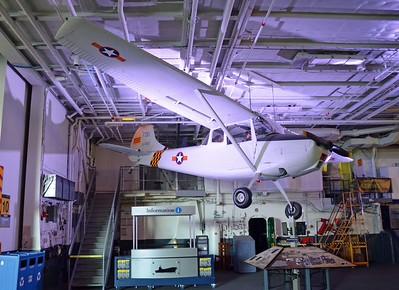 """L-5 """"Bird dog"""" hands in the Hangar Bay"""