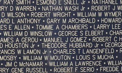 Manuel J Gomez, center, was a former USS Jupiter Crewmen lost in Vietnam