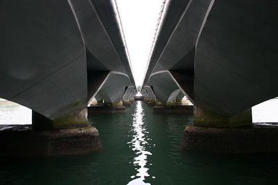 Two bridges cross the Singapore River.