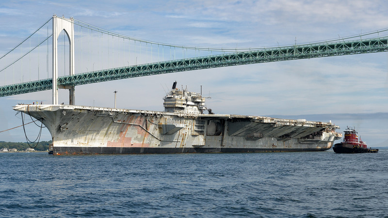"Class & type:	Forrestal-class aircraft carrier Displacement:	81,101 tons full, 61,235 tons light, 19,866 tons dead Length:	1,063 feet (324 m) Beam:	130 feet (39.6 m) waterline, 252 feet (76.8 m) extreme Draft:	37 feet (11.3 m) Propulsion:	4 geared turbines, 4 shafts, 280,000 shp (210,000 kW) 8 Babcock and Wilcox boilers Speed:	35 knots Complement:	552 officers, 4988 men Sensors and processing systems:	AN/SPS-48 3D air search radar AN/SPS-48 2D air search radar AN/SPS-10 surface search radar Electronic warfare & decoys:	Mark 36 SRBOC Armament:	8x 5""/54 caliber Mark 42 guns (127 mm) (removed) NATO Sea Sparrow Phalanx CIWS Aircraft carried:	70–90"