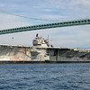 "Class & type:	Forrestal-class aircraft carrier<br /> Displacement:	81,101 tons full, 61,235 tons light, 19,866 tons dead<br /> Length:	1,063 feet (324 m)<br /> Beam:	130 feet (39.6 m) waterline, 252 feet (76.8 m) extreme<br /> Draft:	37 feet (11.3 m)<br /> Propulsion:	4 geared turbines, 4 shafts, 280,000 shp (210,000 kW)<br /> 8 Babcock and Wilcox boilers<br /> Speed:	35 knots<br /> Complement:	552 officers, 4988 men<br /> Sensors and<br /> processing systems:	AN/SPS-48 3D air search radar<br /> AN/SPS-48 2D air search radar<br /> AN/SPS-10 surface search radar<br /> Electronic warfare<br /> & decoys:	Mark 36 SRBOC<br /> Armament:	8x 5""/54 caliber Mark 42 guns (127 mm) (removed)<br /> NATO Sea Sparrow<br /> Phalanx CIWS<br /> Aircraft carried:	70–90"