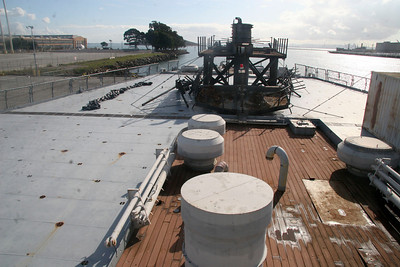 LANDING DECK - Looking aft at IOWA's helicopter landing deck. The upper portion of the mast, currently resting on the stern, will be re-attached to IOWA's mast during her refurbishment at the Port of Richmond.
