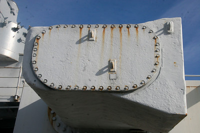 TURRET EARS - A close up of one of the 16-inch Turret No. 3's range-finder hoods. These were nick named ears by the crew, as they stuck out of the sides of the Turrets. Notice the armored side plate is bolted on, rather than welded.