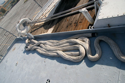 MORRING LINE - One of IOWA's mooring hawsers runs out through a closed chock on the aft starboard side facing the Port of Richmond.