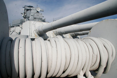 HAWSER STORAGE - Hawser mooring lines are seen stored under IOWA's aft 16-inch gun Turret No. 3. Also seen are the after 5-inch and 16-inch fire control directors above the turret.