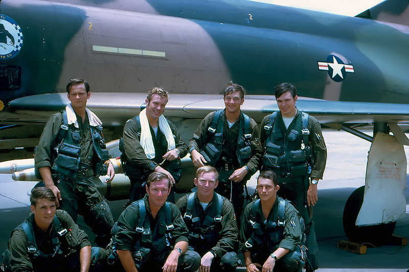 Members of Paula flight, 8JUL72, after Steve Ritchie and Chuck DeBellevue shot down two Mig 21s, kills number 3 and 4.  Back row:  Capt Bryan Tibbett, Capt Steve Ritchie (USAFA '64), Capt Chuck DeBellevue, Lt John Hamm.  Front row:  Lt Bud Hargrove (USAFA '70), Capt Dwain Houck, Lt Tommy Feezel, Lt Bob Hornack