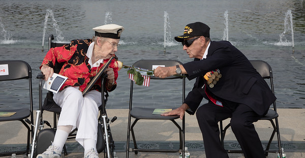US World War II veterans Gerry Corn (L) and Ernest Yamartino chat prior to the ceremony.